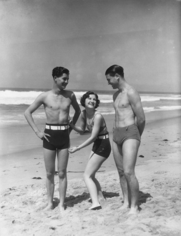 55ba6f478f3 Related. Three women wearing police badges measure the bathing suit.