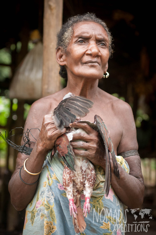 nowhere papua indonesia forest jungle wild wilderness tribal traditional culture travel adventure explore trek discover journey guide wonder dangerous survival village island tropical remote undiscovered bird food women dress