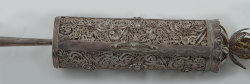 ofskfe:Scroll of Esther, Venice, 18th centuryThis Venetian eighteenth century Scroll of Esther is enclosed within an elegant tubular scrolled filigree case. The cylindrical case of delicate silver filigree is beautifully decorated with floral motifs, with a gilded, flower-shaped element on top. In contrast to its richly ornamented case, the parchment scroll is very simple and has no decorations around the handwritten text. U. Nahon Museum of Jewish Italian Art Gift of Mrs. Zaban in memory of her parents, who were murdered in Auschwitz. Trieste, 1987