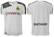 8. Dortmund's kits are typical Puma. Even when they do a basic white Puma touches it up with an eye catching grey.