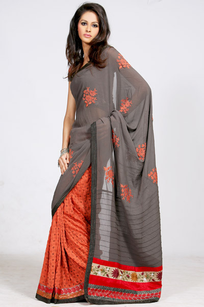 Gray and orange sari by RaiR (SARAIR0948)  Pretty saree in light orange shade features a colourful brocade patch border decorated with paisely designs, along with a black patch border embellished with silver zari threads. Saree is printed with beautiful floral motifs in elephant grey shade. Pallu in elephant grey shade is embellished with floral motifs in orange using resham. Lower half of the pallu is accentuated with pintucks, along with a red and beige patch border decorated with beautiful floral patterns embellshed using multicoloured resham threads. Paired with a elephant grey shade blouse with embellished sleeves. A crushed georgette saree.    // robot-heart: Spring Summer 09 - Sarees | Cbazaar's Blog