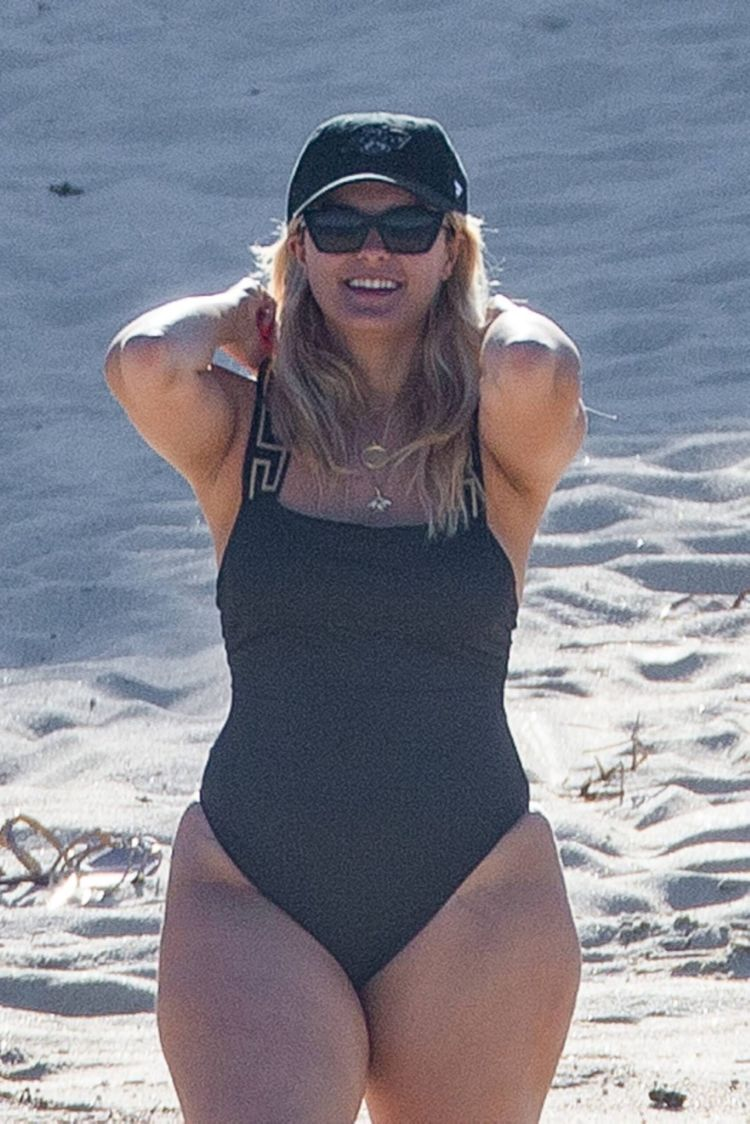 Bebe Rexha In A Black Swimsuit On The Beach In Cabo San Lucas
