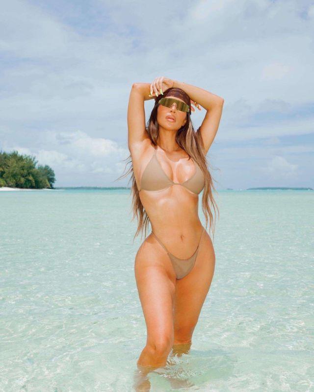 Kim Kardashian Poses For A Bikini Shoot At The Beach