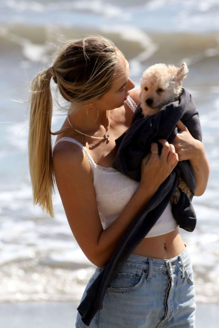 Alexis Ren Spotted At The Beach With Her Puppy In Malibu