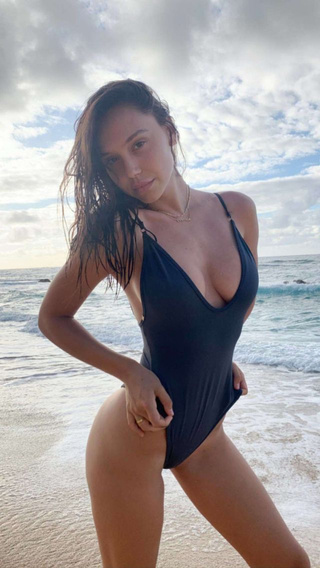 Alexis Ren Vacationing In Black Swimsuit At The Beach