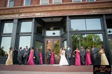 Front-of-building-wedding-party