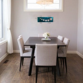 aged teal holy stix look fantastic as the wall art under the window in this family dining space