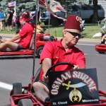 Mike Tollefson driving a Shriner go-cart.