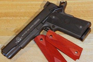 Before: A stock parkerized 1911 was degreased given wood grips, and coated with DuraBlue and DuraBlue Nitre.