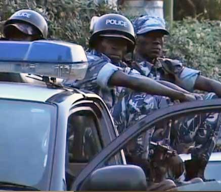 Ugandan police at June 18 raid. (Photo courtesy of NTV. Click for video.)