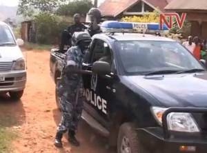 Police raid LGBT rights meeting near Kampala, Uganda. (Photo courtesy of NTV. Click photo to see the video.)