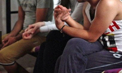 Three LGBT interviewees in Iraqi safe house, with their identifies concealed for safety. (Photo courtesy of BBC)