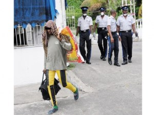 Police evicted gay men from abandoned house in Millborough. (Photo courtesy of Jamaica Gleaner)