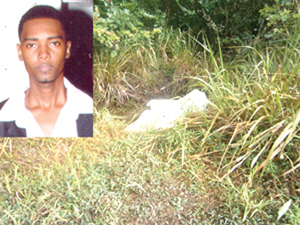 The body of Delon Melville and the bushes where his body was found (Photo courtesy of Kaieteur News)