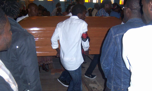 Eric Lembembe's coffin arrives at the Aug. 2 vigil. (Photo courtesy of Camfaids)