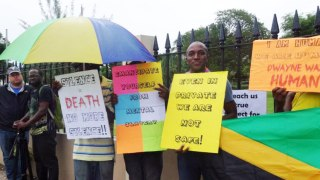 Maurice Tomlinson and other protesters take part in LGBT Jamaicans Stand Against Violence.