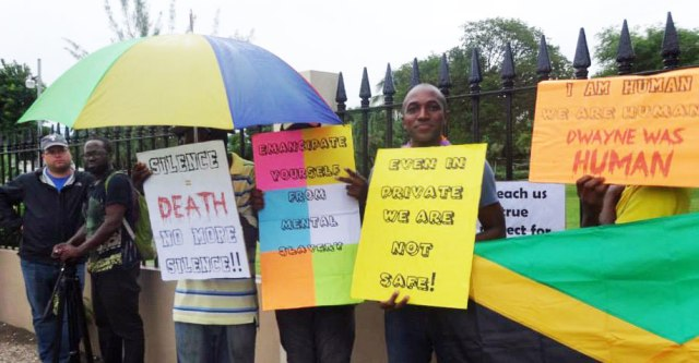 Maurice-Tomlinson-and-LGBT-protesters-stand-09-2013