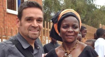 J.P. Conly meet with Maxensia Nakibuuka in Uganda (Photo courtesy of San Diego Gay & Lesbian News)