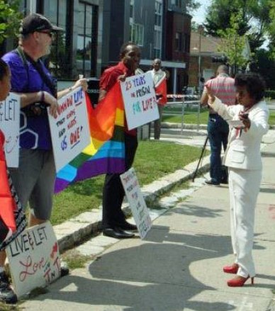 Trinidad's consul general, Dr. Vidhya Gyan Tota-Maharaj (right), pleads with the protesters at the Stand for Liberty on Aug. 28, 2015. (Photo courtesy of Maurice Tomlinson)