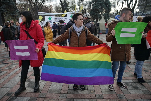 Dozens of demonstrators supporting a ban on anti-LGBTI bias protested outside the Ukrainian parliament on Nov. 12 before the ban was approved. (Photo by Kostyantyn Chernichkin courtesy of Kyiv Post)