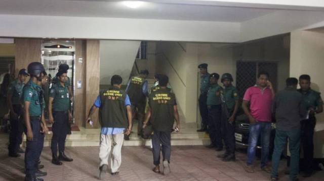 Investigators arrive at Dhaka crime scene. (Photo courtesy of Dhaka Tribune)