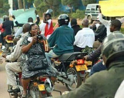 Stella Nyanzi documenting a protest in Uganda for research she was doing on that subject. (Photo courtesy of Facebook)