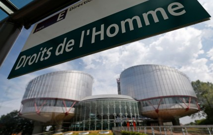 "French-language sign at a tram stop reads ""Human rights"" in front of the European Court of Human Rights in Strasbourg, France. (Photo courtesy of Newsweek)"