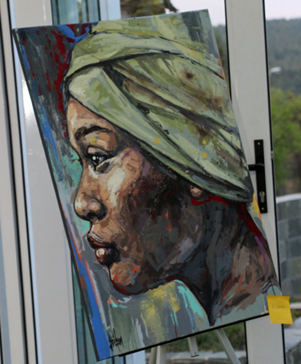 Painting at Gateway Health Institute art exhibit / fundraiser. (Photo courtesy of Gateway Health Institute)