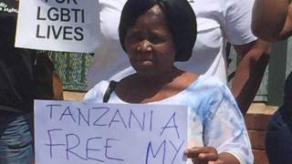 The mother of arrested human rights lawyer Sibongile Ndashe protests at the Tanzanian High Commission in South Africa. (Photo courtesy of Facebook)