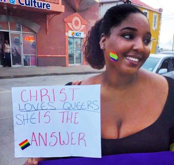 "Counter-protester declares: ""Christ Loves Queers"" (Photo from Facebook)"