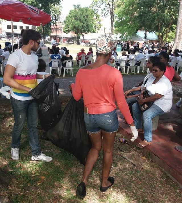 LGBT+ community and friends clean up litter in Woodford Square during anti-LGBT rally. (Photo courtesy of Facebook)