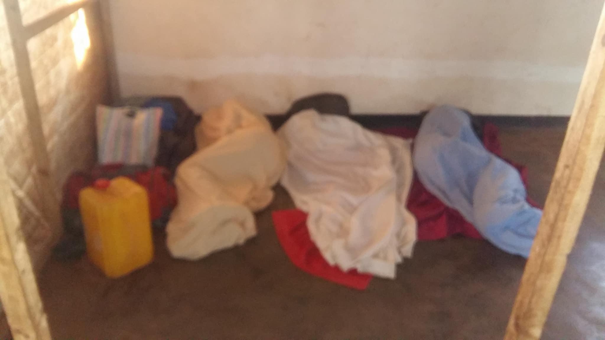 Three Ugandan LGBTI refugees sleep on the ground in Malawi. (Photo courtesy of Refugee Flag Kakuma)