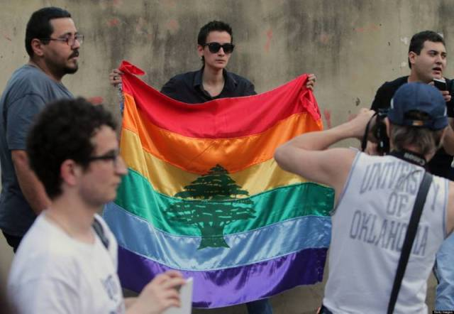 LGBT rights demonstrator displays combination of Lebanon's flag and a rainbow flag (AFP photo courtesy of Annahar.com)