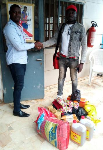 LGBT rights group Humanity First Cameroon receives food that they will deliver to gay prisoners on as part of the Not Alone / Pas Seul project. (Photo courtesy of Steeves Winner)