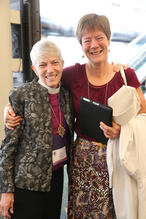 Bishop Mary Glasspool (left) and her spouse, Becki Sander, in 2015. (Photo courtesy of Episcopal News)
