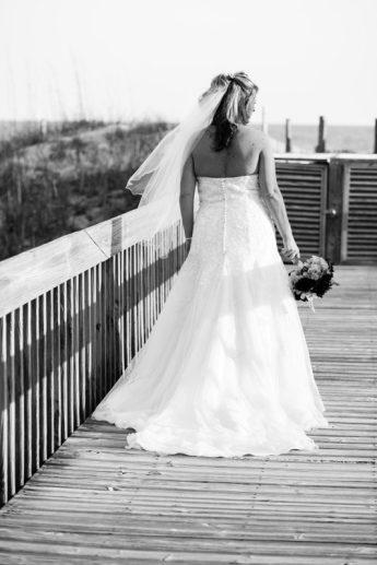 Bride on boardwalk in black & white