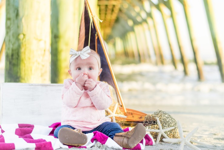 Baby under pier at Myrtle Beach photo sesion