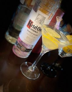 Interview-Straight-Up Bar Consulting. Dee Bertison's favorite drink, an image of Ketel One Vodka and a yellow lemon slice in a martini glass.