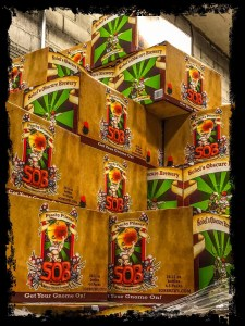 Interview-Sobel's Obscure Brewery. Image of cases of Peachy Pilsner stacked upon one another with a black border.