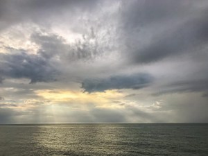 A Week Away. Photograph of the morning sunrise and cloud cover over the Atlantic Ocean.