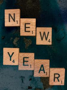Way back in 2020. Scrabble pieces spelling New Year with a retro background.