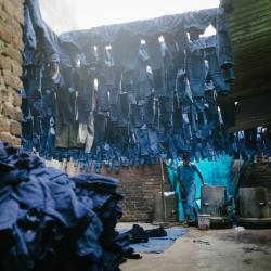 A man works in a factory that dyes blue jeans in Silampur district, one of the most polluted and densely populated parts of Delhi.