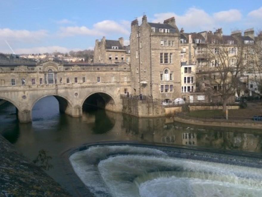 Pulteney Bridge: A stone bridge crosses a river in the English city of Bath