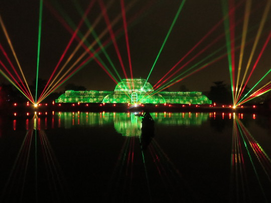 Light show over the lake and greenhouse as part of Christmas at Kew
