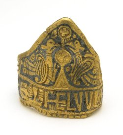 archaicwonder:Ring of Æthelwulf, Anglo-Saxon, AD 828-858  Gold nielloed mitre-shaped ring, decorated with peacocks, crosses, rosettes, foliage and a tree. Found in a cart rut in Laverstock, Wiltshire, England. Æthelwulf was the King of Wessex (r. AD 836-858) and was the father of Alfred the Great. The ring, a particularly ambitious piece, was not the king's personal ring, but was presumably given as a gift or as a mark of royal office. Its fine Trewhiddle-style ornament would certainly fit a mid ninth-century date.