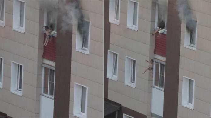Очевидцы сняли невероятное спасение семьи с детьми из горящей квартиры