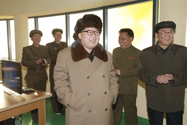 North Korea leader Kim Jong Un smiles after watching the test of a new engine for an ICBM at Sohae Space Center