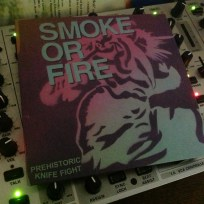 Smoke Or Fire – Prehistoric Knife Fight | Front