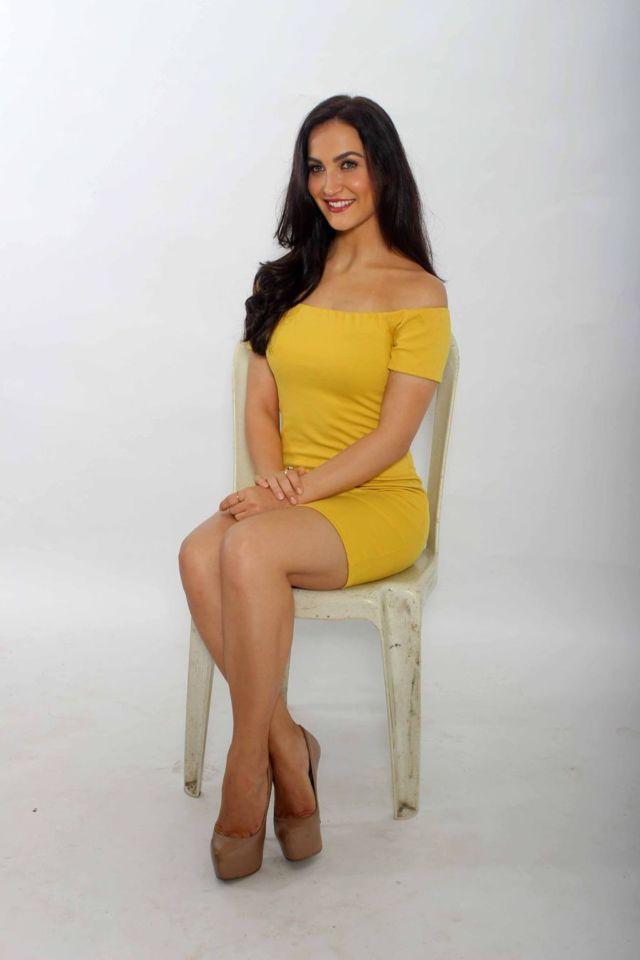 Elli Avram Showcases Her Gorgeous Pins In Yellow Dress