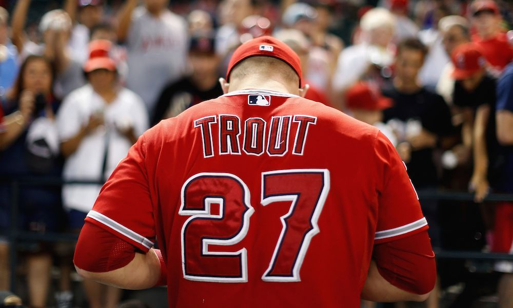 PHOENIX, AZ - JUNE 18:  Mike Trout #27 of the Los Angeles Angels signs autographs for fans before the MLB game against the Arizona Diamondbacks at Chase Field on June 18, 2015 in Phoenix, Arizona.  (Photo by Christian Petersen/Getty Images)